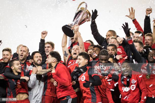 Captain Michael Bradley of Toronto FC screams as he hoists the MLS Championship Cup and celebrates with teammates after the 2017 Audi MLS...