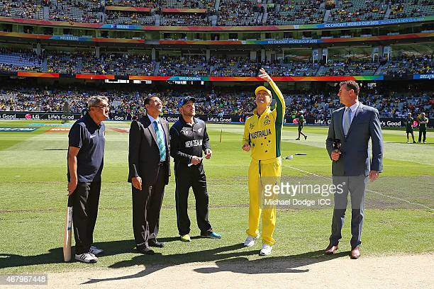 Captain Michael Clarke of Australia tosses the coin next to Brendon McCullum of New Zealand during the 2015 ICC Cricket World Cup final match between...