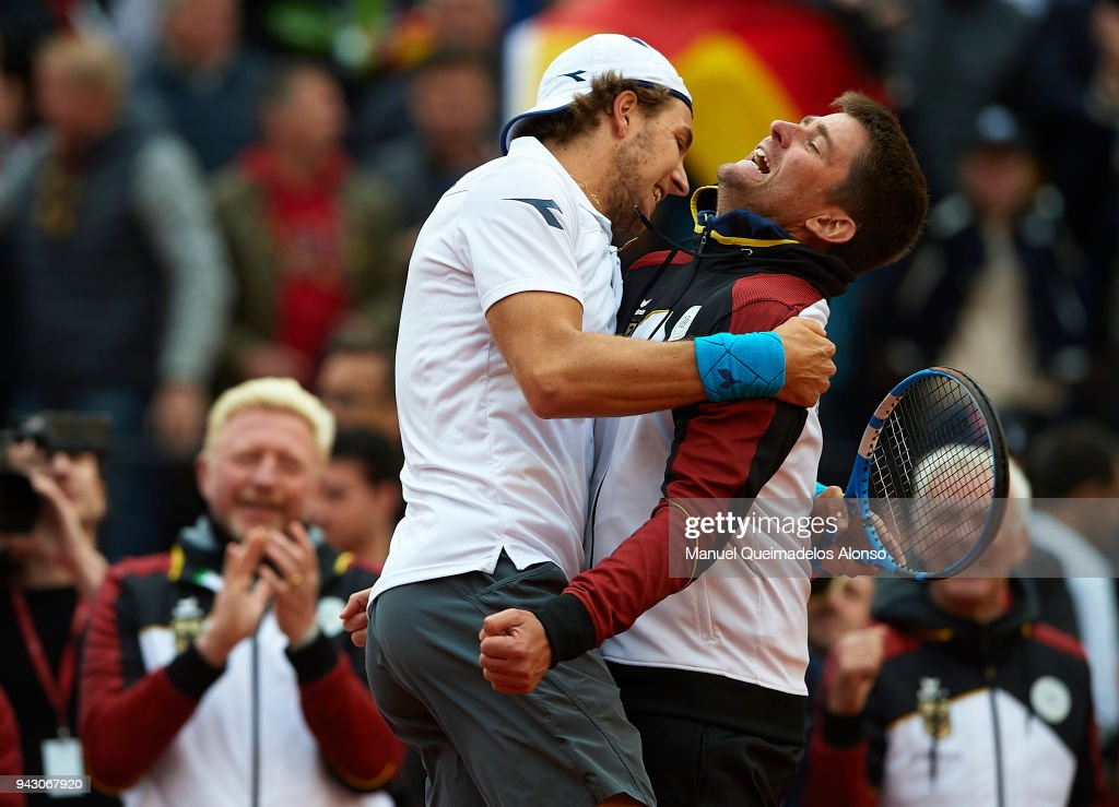 Captain Michael Kohlmann celebrates the victory with his player a point Jan-Lennard Struff of Germany during their match against Feliciano Lopez and Marc Lopez of Spain in the doubles during day two of the Davis Cup World Group Quarter Final match between Spain and Germany at Plaza de Toros de Valencia on April 7, 2018 in Valencia, Spain.