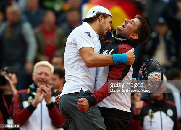 Captain Michael Kohlmann celebrates the victory with his player a point JanLennard Struff of Germany during their match against Feliciano Lopez and...