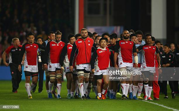 Captain Michael Leitch of Japan leads his team out during the 2015 Rugby World Cup Pool B match between USA and Japan at Kingsholm Stadium on October...
