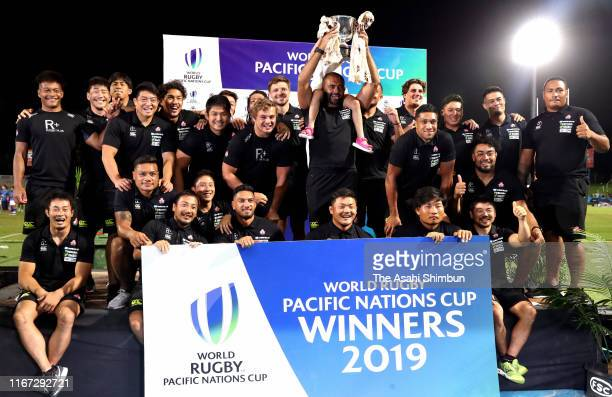 Captain Michael Leitch of Japan lifts the trophy after the Pacific Nations Cup match between Japan and the United States at the ANZ Stadium on August...