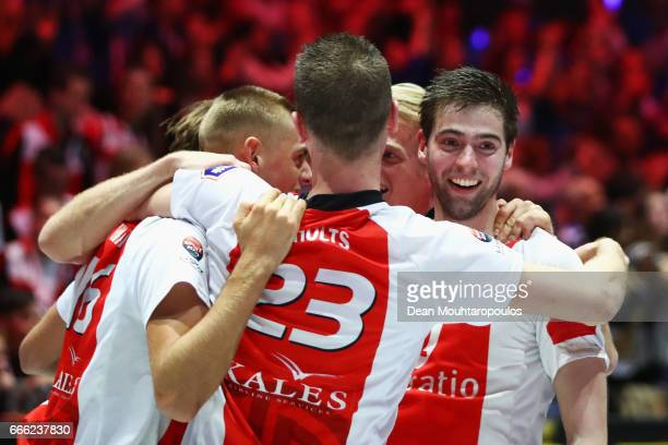 Captain Mick Snel of Top/Quoration leads the celebration with team mates after victory in the Dutch Korfball League Final between BlauwWit and...