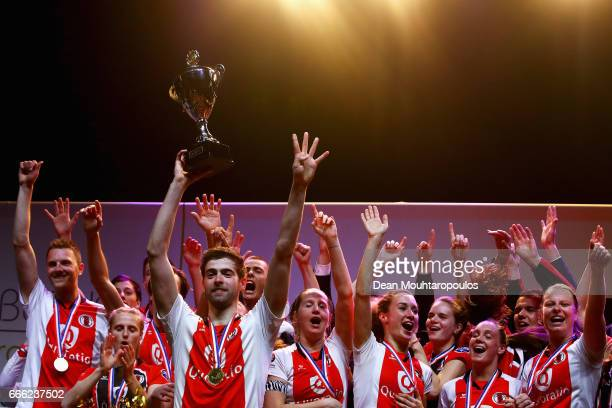 Captain Mick Snel of Top/Quoration leads the celebration with the trophy after victory in the Dutch Korfball League Final between BlauwWit and...
