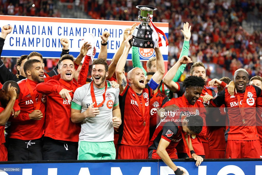 Captain Midfielder Michael Bradley #4 of Toronto FC lifts up the Voyageur Cup with his teammates and celebrate their Canadian Championship after defeating the Montreal Impact 2 - 1 during Leg 2 of the 2017 Canadian Championship and 3 - 2 on aggregate on June 27, 2017 at BMO Field in Toronto, Canada.