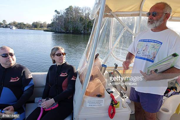 Captain Mike Dunn who runs Manatees in Paradise talks to tourists on March 9 2016 about how to swim with manatees without harassing the endangered...