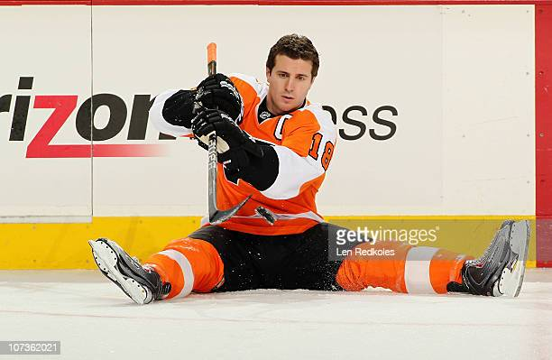 Captain Mike Richards of the Philadelphia Flyers stretches and shoots a puck during warmups before his game against the New Jersey Devils on December...