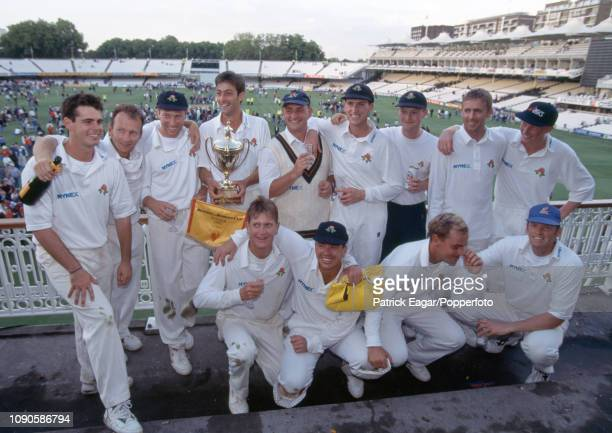 Captain Mike Watkinson and the Lancashire team celebrate after winning the Benson and Hedges Cup Final between Kent and Lancashire by 35 runs at...