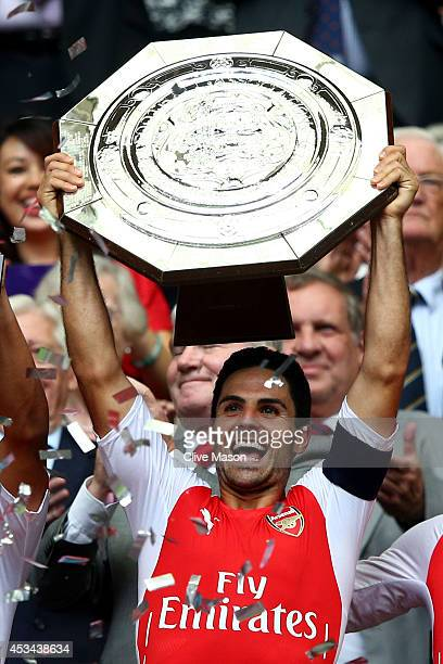 Captain Mikel Arteta of Arsenal holds up the trophy after winning the FA Community Shield match between Manchester City and Arsenal at Wembley...