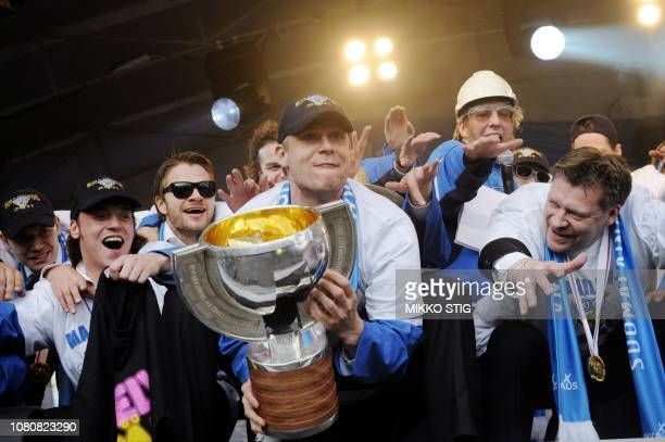Captain Mikko Koivu holds the trophy while head coach Jukka Jalonen during celebrations for Team Finland, after winning the ice hockey world...