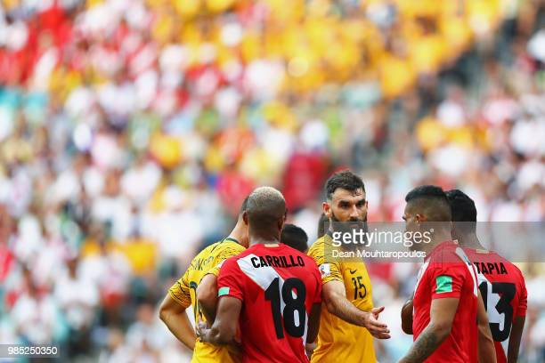 Captain Mile Jedinak of Australia shakes hands with Anderson Santamaria of Peru during the 2018 FIFA World Cup Russia group C match between Australia...