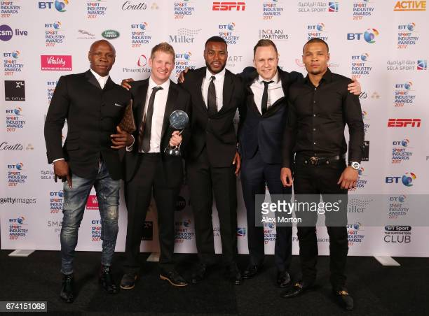 Captain Morgan for Captain Wes Morgan pose with the Best Use of PR award in association with Getty Images with Chris Eubank and Chris Eubank Jr...
