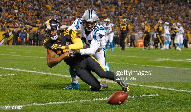 Captain Munnerlyn of the Carolina Panthers breaks up a pass intended for JuJu SmithSchuster of the Pittsburgh Steelers during the third quarter in...