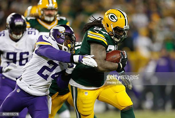 Captain Munnerlyn of the Minnesota Vikings attempts to tackle Eddie Lacy of the Green Bay Packers during the second half of their game at Lambeau...