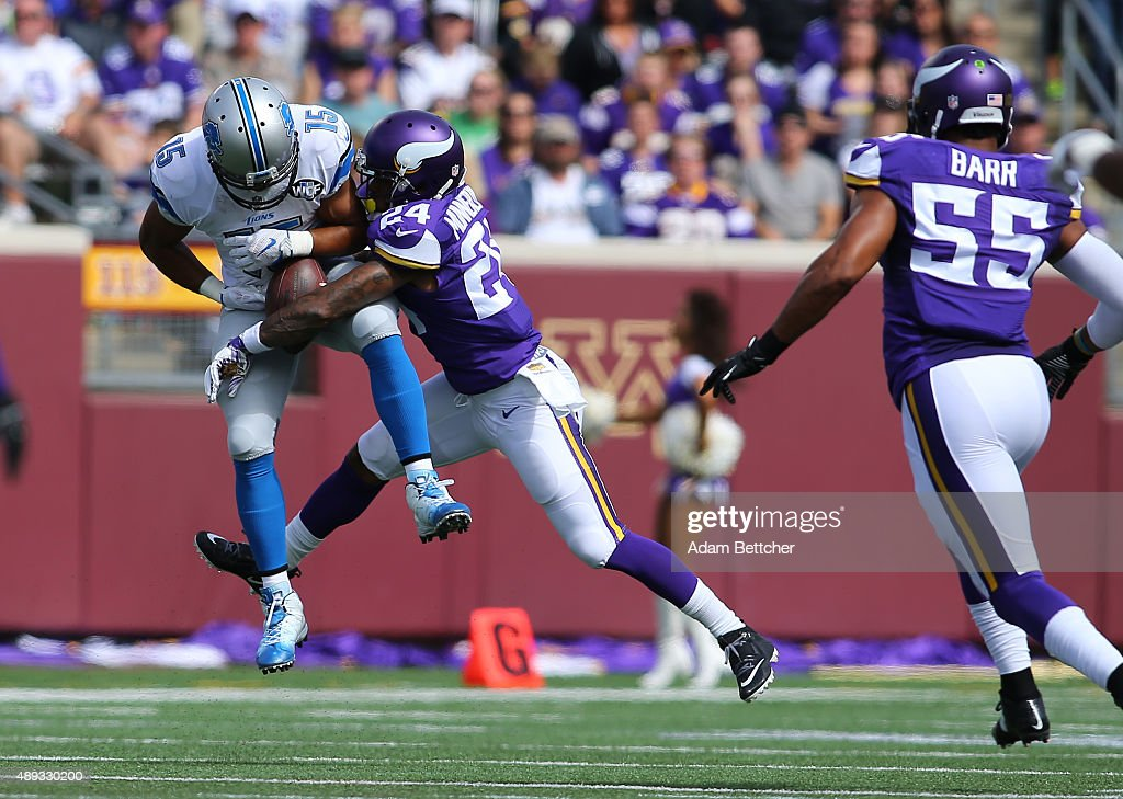 Captain Munnerlyn #24 of the Minnesota Vikings breaks up a pass intended for Golden Tate #15 of the Detroit Lions in the second quarter at TCF Bank Stadium on September 20, 2015 in Minneapolis, Minnesota.