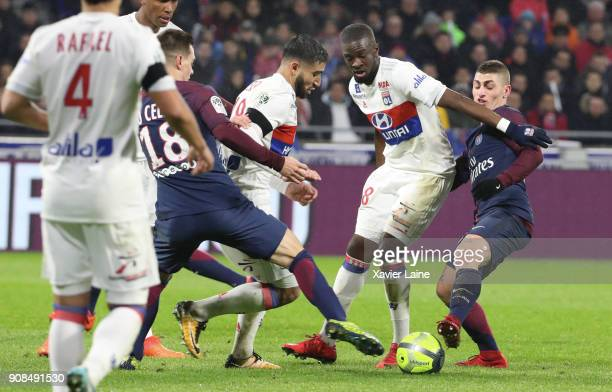Captain Nabil Fekir and Houssem Aouar of Olympique Lyonnais in action with Giovani Lo Celso and Marco Verratti of Paris SaintGermain during the Ligue...