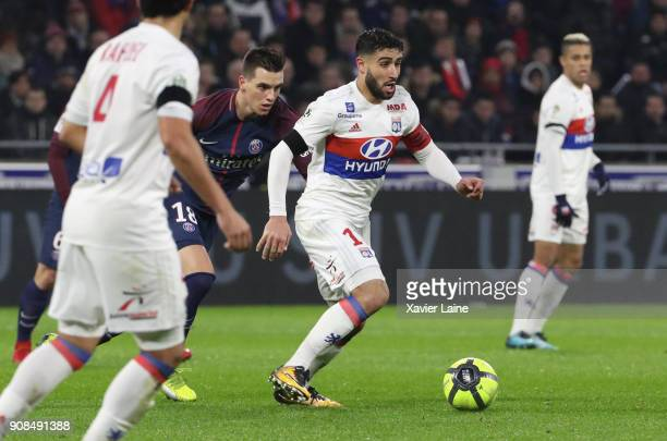 Captain Nabil Fekir of Olympique Lyonnais in action with Giovani Lo Celso of Paris SaintGermain in action during the Ligue 1 match between Olympique...