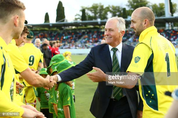 XI captain Nathan Lyon introduces the Australian Prime Minister Malcom Turnbull to the team before the One Day Tour Match between the Prime...