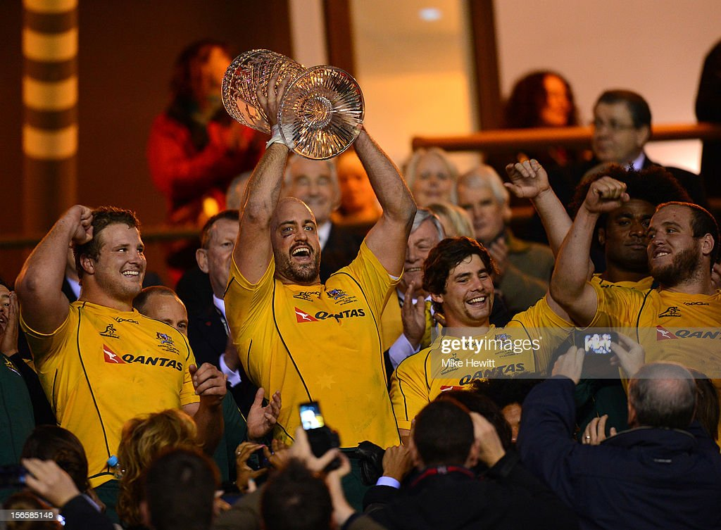Captain Nathan Sharpe (2nd L) of Australia lifts the Cook Cup during the QBE International match between England and Australia at Twickenham Stadium on November 17, 2012 in London, England.