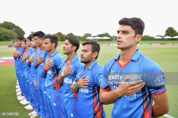 Captain Naveen Ul Haq of Afghanistan and his team mates line up for their national anthems prior to the ICC U19 Cricket World Cup Semi Final match...