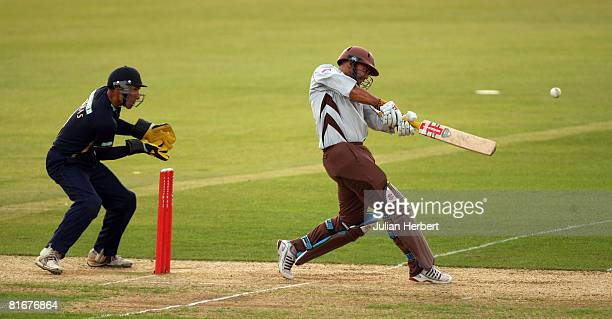 Captain Nic Pothas of The Hampshire Hawks watches as Scot Newman of The Surrey Brown Caps hits out during the Twenty20 Cup match between Hampshire...