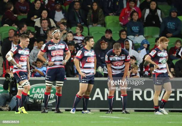 Captain Nic Stirzaker and the Rebels look dejected after the Crusaders scored a try during the round 14 Super Rugby match between the Rebels and the...