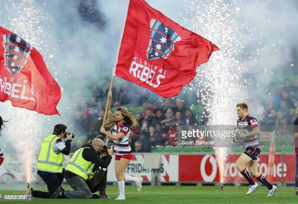 Captain Nic Stirzaker leads the Rebels onto the field during the round 14 Super Rugby match between the Rebels and the Crusaders at AAMI Park on May...