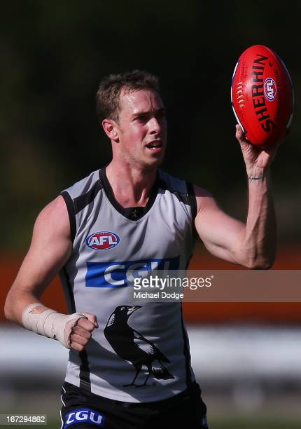 Captain Nick Maxwell recovering from a wrist injury handles the ball with only his right hand during a Collingwood Magpies AFL training session at...