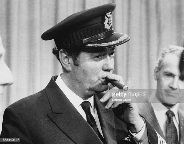 Captain Norman Todd the pilot of British Airways Concorde celebrates with a cigar after the aircrafts inaugural flight to Bahrain and back at London...