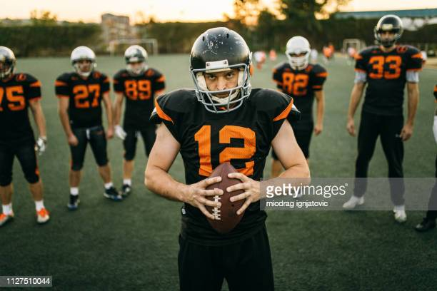 captain of american football team - team captain stock pictures, royalty-free photos & images