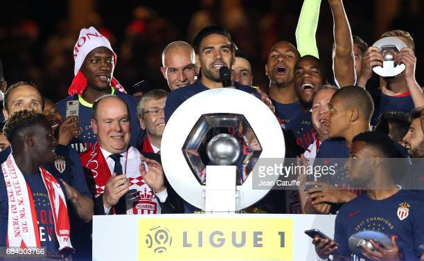 Captain of AS Monaco Radamel Falcao speaks before holding the trophy while Prince Albert II of Monaco looks on during the French League 1...