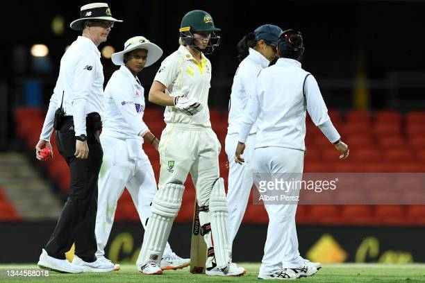 Captain of Australia Meg Lanning speaks to India captain Mithali Raj before declaring a draw during day four of the Women's International Test Match...