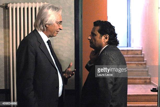 Captain of Costa Concordia Francesco Schettino speaks with his lawyer Domenico Pepe during the a break for his trial where he gave evidence for the...