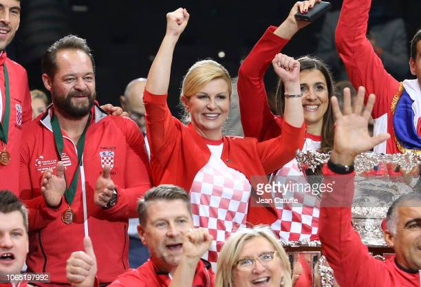 Captain of Croatia Zeljko Krajan President of Croatia Kolinda GrabarKitarovic President of Croatian Tennis Association Nikolina Babic celebrate...