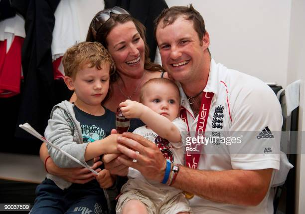Captain of England Andrew Strauss celebrates with the Ashes Urn in the changing room with his wife Ruth and sons Samuel and Luca following the fifth...