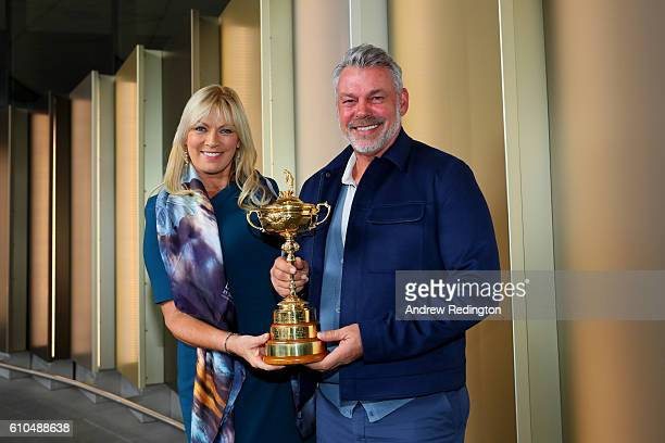 Captain of Europe Darren Clarke and his wife Alison Clarke pose with the Ryder Cup before departing Heathrow Airport Terminal 5 ahead of the 2016...
