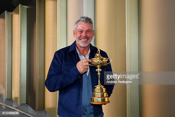 Captain of Europe Darren Clarke poses with the Ryder Cup before departing Heathrow Airport Terminal 5 ahead of the 2016 Ryder Cup on September 26...