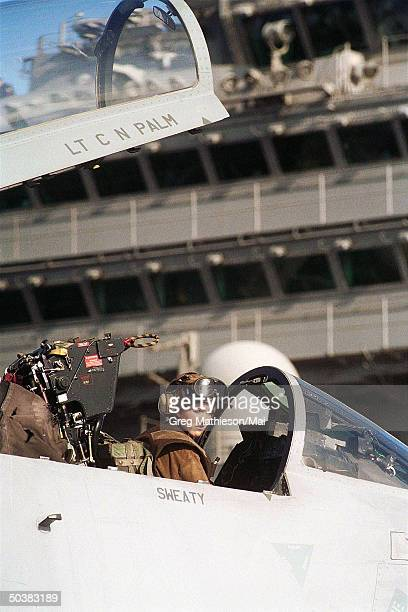 Captain of F14 Tomcat from the Diamondbacks of Fighter Squadron One Zero Two looking for further instructions from her flight deck crew aboard USS...