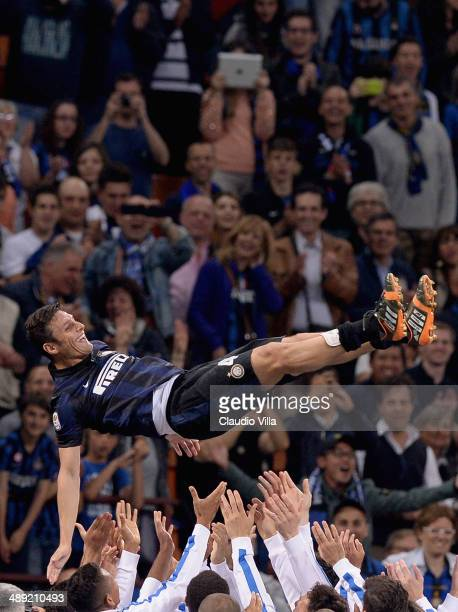 Captain of FC Inter Milano Javier Zanetti celebrates after the last match of his career at San Siro Stadium the Serie A match between FC...