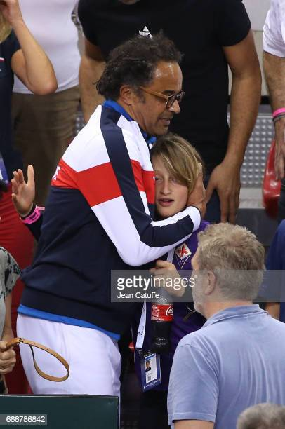 Captain of France Yannick Noah and his son Joalukas Noah following the victory 30 on day 2 of the Davis Cup World Group quarter final tie between...