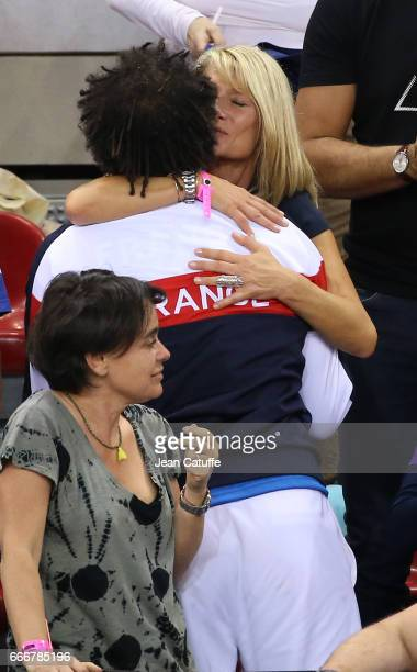 Captain of France Yannick Noah his wife Isabelle Camus following the victory 30 on day 2 of the Davis Cup World Group quarter final tie between...