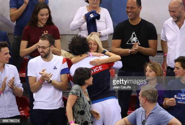 Captain of France Yannick Noah his wife Isabelle Camus their son Joalukas Noah following the victory 30 on day 2 of the Davis Cup World Group quarter...
