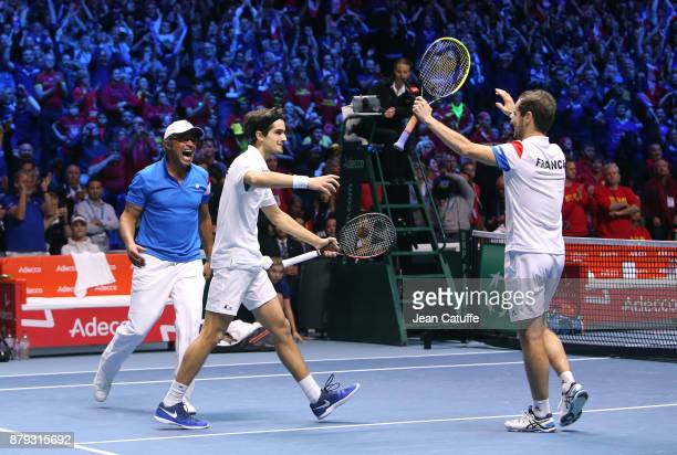 Captain of France Yannick Noah PierreHughes Herbert and Richard Gasquet of France celebrate winning the doubles match during day 2 of the Davis Cup...