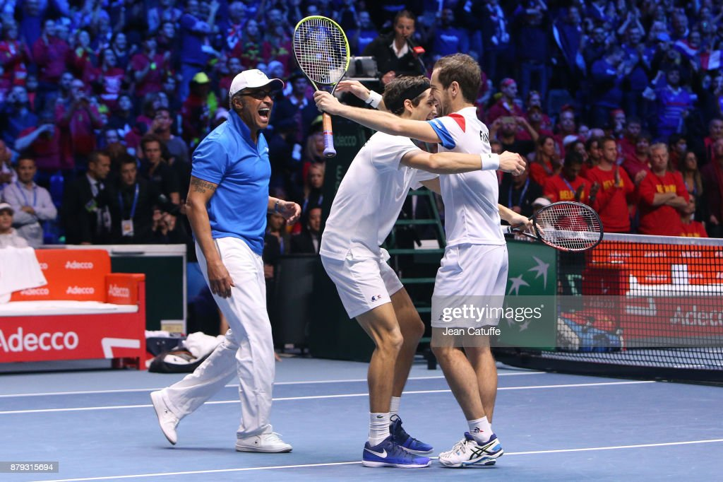 Captain of France Yannick Noah, Pierre-Hughes Herbert and Richard Gasquet of France celebrate winning the doubles match during day 2 of the Davis Cup World Group final between France and Belgium at Stade Pierre Mauroy on November 25, 2017 in Lille, France.