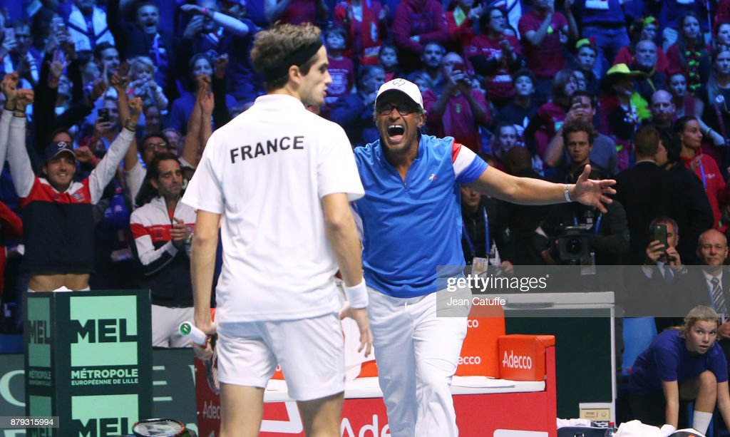 Captain of France Yannick Noah, Pierre-Hughes Herbert and Richard Gasquet (not pictured) of France celebrate winning the doubles match during day 2 of the Davis Cup World Group final between France and Belgium at Stade Pierre Mauroy on November 25, 2017 in Lille, France.