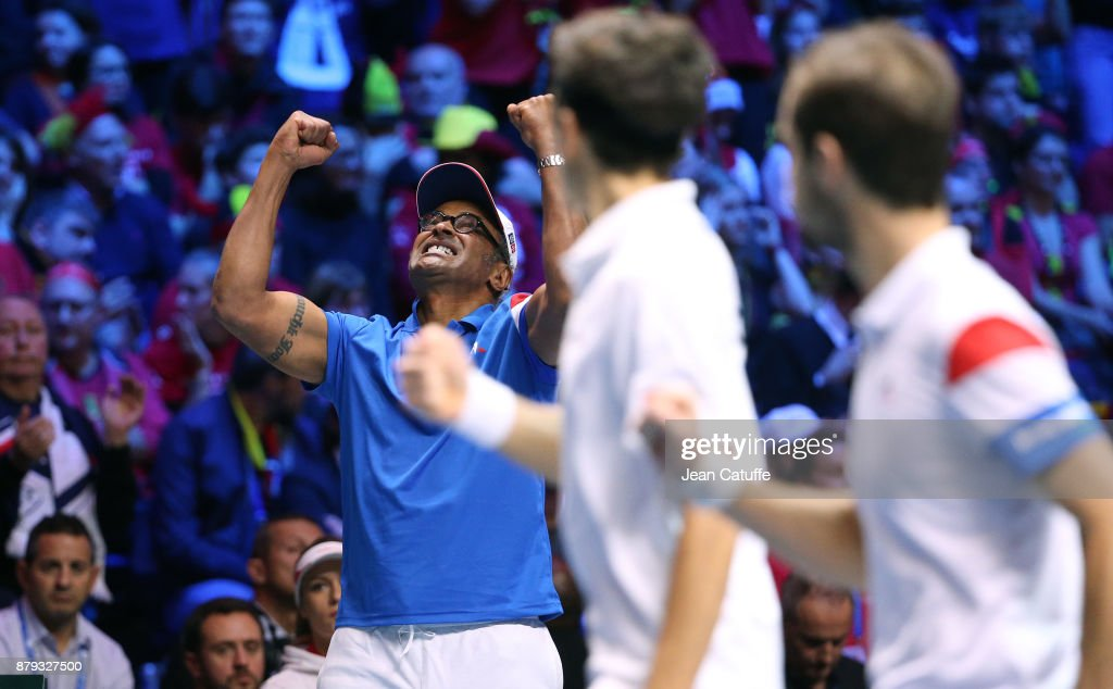 Captain of France Yannick Noah, Pierre-Hughes Herbert and Richard Gasquet of France celebrate winning a point during the doubles match on day 2 of the Davis Cup World Group final between France and Belgium at Stade Pierre Mauroy on November 25, 2017 in Lille, France.