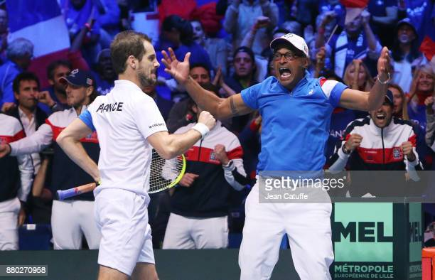 Captain of France Yannick Noah Richard Gasquet during the doubles match on day 2 of the Davis Cup World Group final between France and Belgium at...