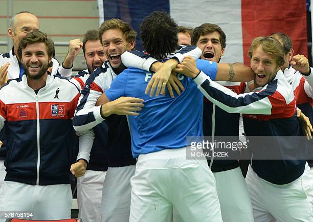 Captain of French Davis Cup team Yannick Noah celebrates with teammates after JoWilfried Tsonga of France won over Jiri Vesely of Czech Republic at...