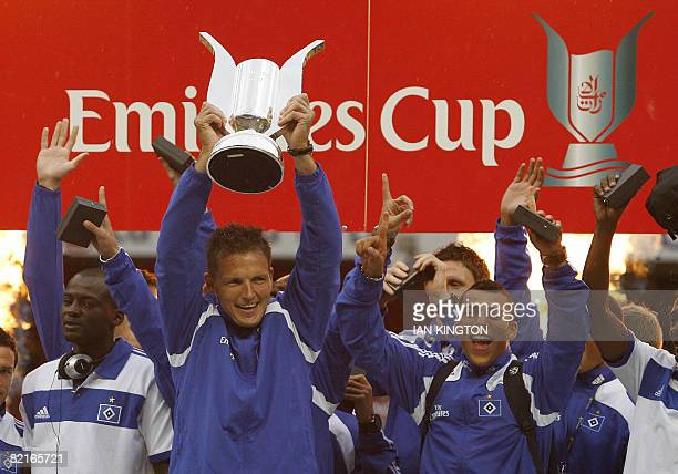 Captain of Hamburg SV Frank Rost lifts the trophy after Hamburg SV win the Emirates Cup during the Emirates Cup competition at the Emirates stadium...