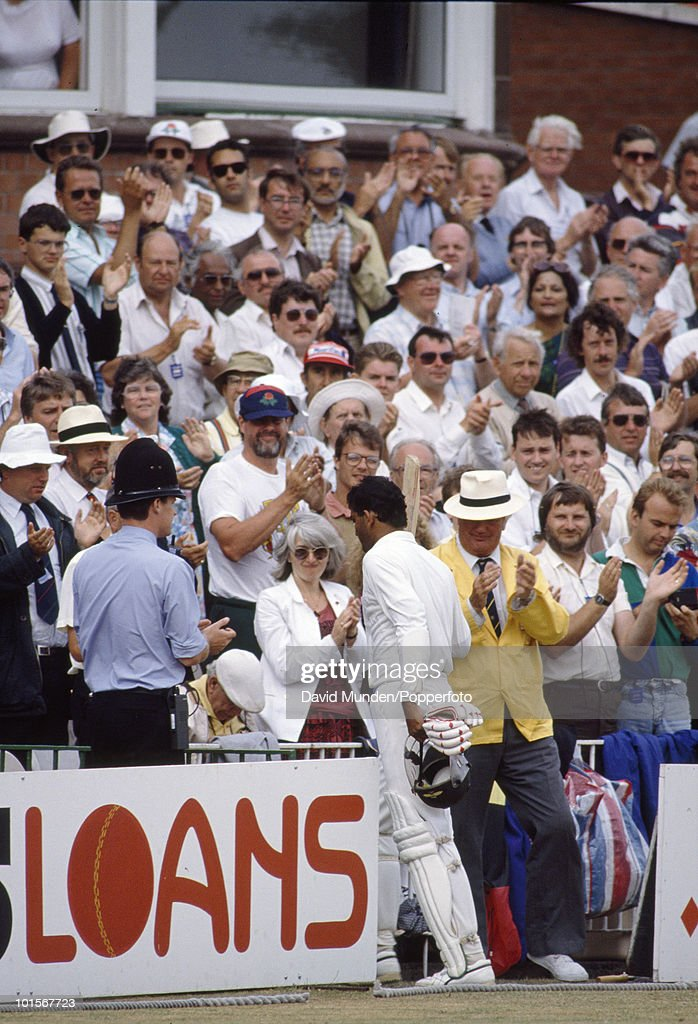 Captain of India Mohammad Azharuddin receives a standing ovation as he returns to the pavilion having scored 179 on the third day of the 2nd Test match between England and India at Old Trafford in Manchester, 11th August 1990. The match ended in a draw.